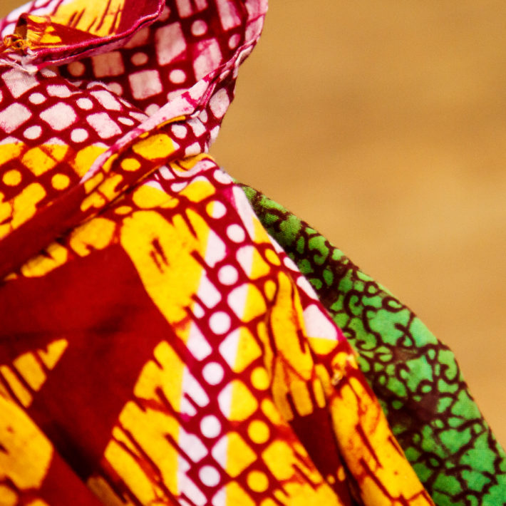 An artistic picture of a piece of cloth that is colourful and with African design