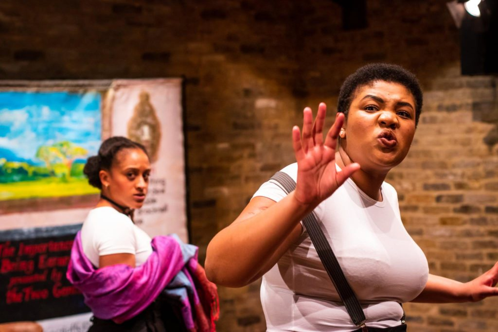 Two actresses called Ayesha Casely-Hayford and Kudzanayi Chiwawa perform The Importance of Being Earnest by Oscar Wilde